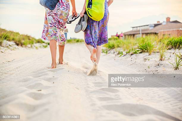 Two girls, sisters, walks to the beach