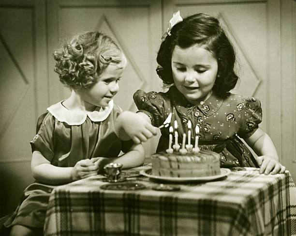 two girls (3-4), (4-5) sitting at small table with birthday cake, (b&w) - best friend birthday cake stock pictures, royalty-free photos & images