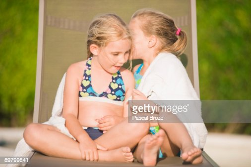 Swell Two Girls Sitting On A Lounge Chair And Whispering High Res Camellatalisay Diy Chair Ideas Camellatalisaycom