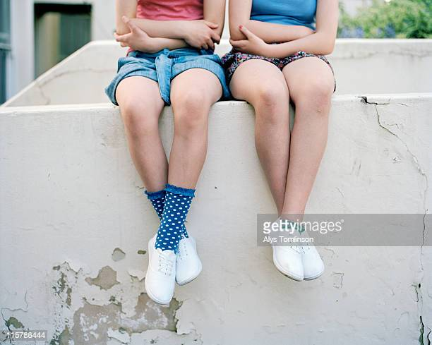 Two Girls Sitting on a Wall