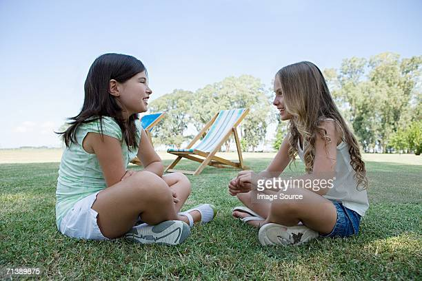 Two girls sitting on the grass