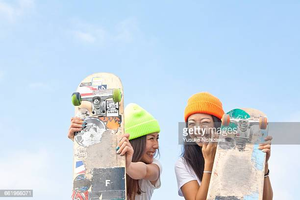 Two girls skaters laughing