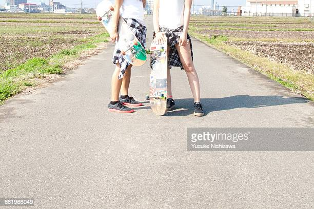 two girls skaters - yusuke nishizawa stock pictures, royalty-free photos & images