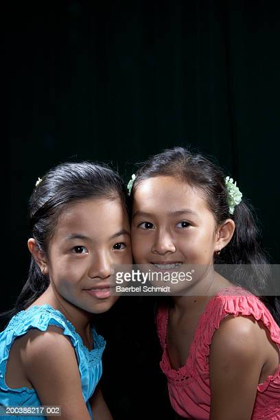 Two girls (8-10) smiling, portrait