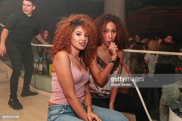 Two girls smoke shisha from a hookah pipe during the 'Purpose Tour' Party, Justin Bieber after concert at Pacha Barcelona on November 22, 2016 in...