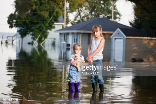 Two Girls Standing Alone In Flood Water Stock Photo - Getty Images-5765