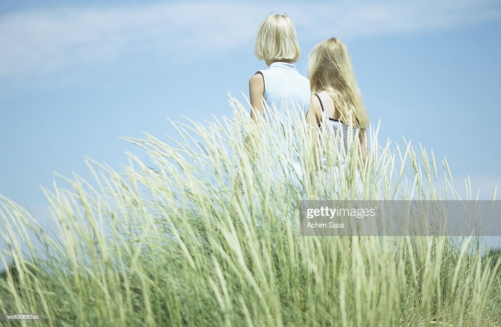 Two girls standing, rear view : Stock Photo