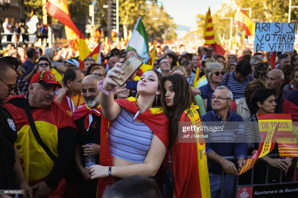 Two girls take a selfie as thousands of pro-unity protesters gather in Barcelona, two days after the Catalan parliament voted to split from Spainon October 29, 2017 in Barcelona, Spain. The Spanish government has responded by imposing direct rule and dissolving the Catalan parliament.
