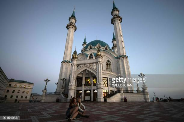 Two girls take a selfiephoto in front of Qolsharif mosque at Kremlin in Kazan on July 4 2018 during the Russia 2018 World Cup football tournament