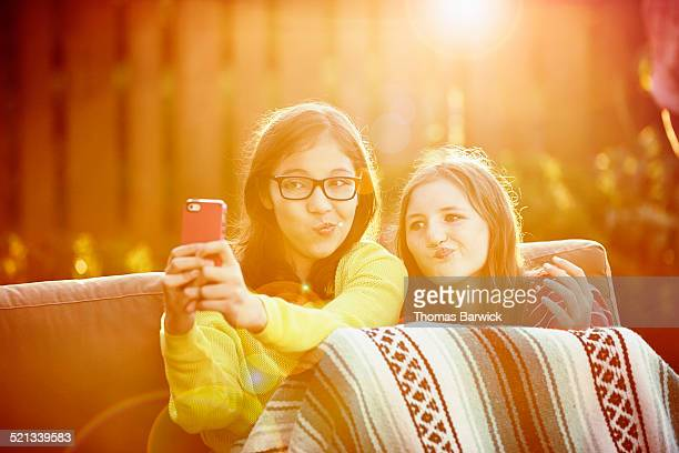 Two girls taking self portrait with smartphone