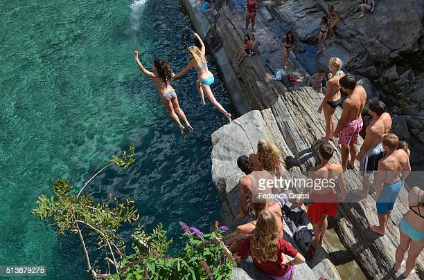 Two Girls taking the plunge