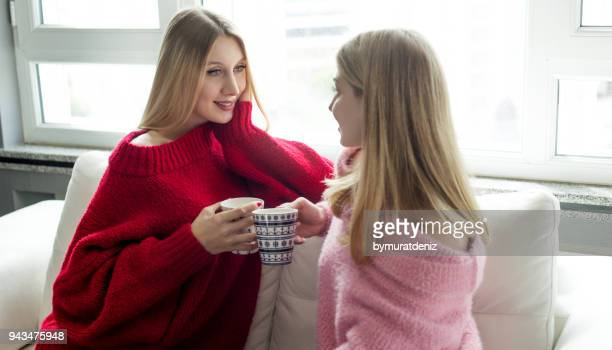 two girls talking with coffee cups - beautiful turkish girl stock pictures, royalty-free photos & images