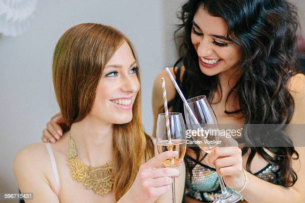 Two girls toasting with champagne flutes