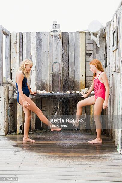 Two girls under a beach shower