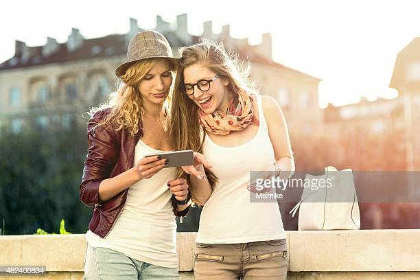 Two girls using smart phones