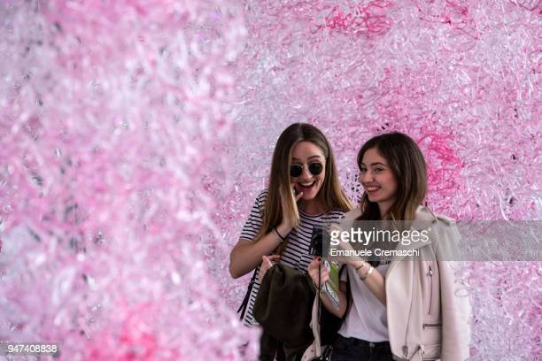Two girls visit the installation 'Limbo' at the University of Milan on April 16 2018 in Milan Italy Every year Salone and Fuorisalone define the...