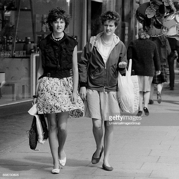 Two girls wailking along the Kings Road London September 1982