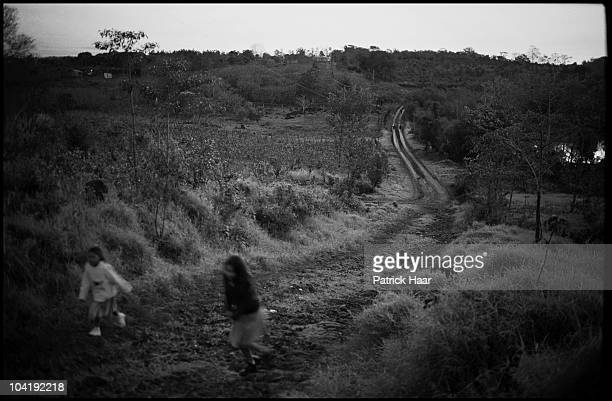 Two girls walk in the outsides of the village 2005 Tamandua, Argentina. Tamandua is a small town located just 30 miles from Oberá in the Northern...