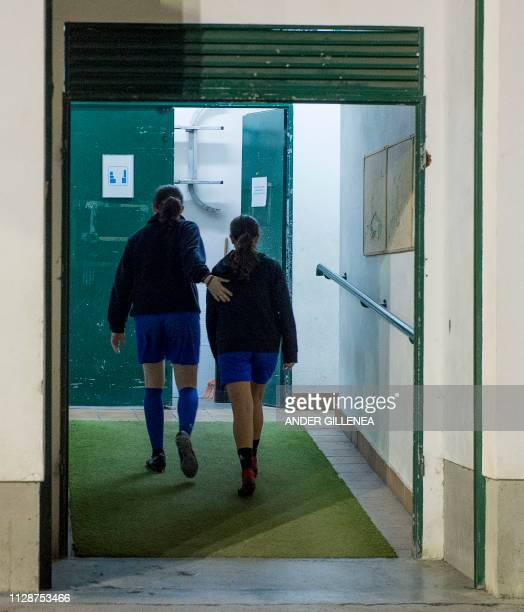 Two girls walk into de locker room after attending a training session at the Anorga KKE football school in the Spanish Basque city of San Sebastian...