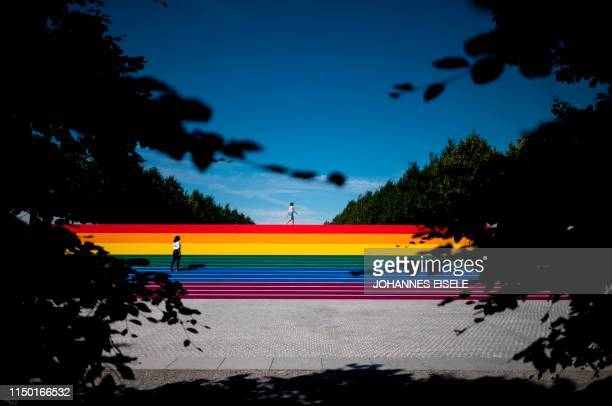 Two girls walk on steps covered in rainbow colors for Pride Month at Franklin D Roosevelt Four Freedoms Park on June 15 2019 in New York City...
