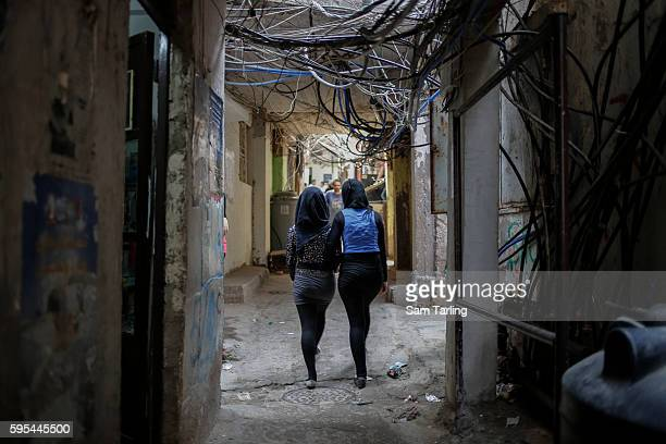 Two girls walk through Bourj al Barajneh Palestinian refugee camp in Beirut Lebanon on May 17 2013 This already crowded camp has had it's numbers...
