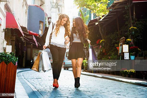Two girls walking back home from shopping day in Istanbul