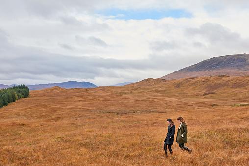 Two girls walking in landscape - gettyimageskorea