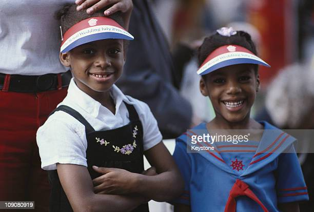 Two girls wearing hats during the celebrations for the wedding of Prince Charles and Lady Diana Spencer London 29th July 1981