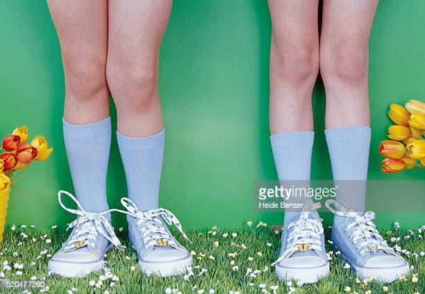 two girls wearing same sneakers and socks - adjust socks stock pictures, royalty-free photos & images