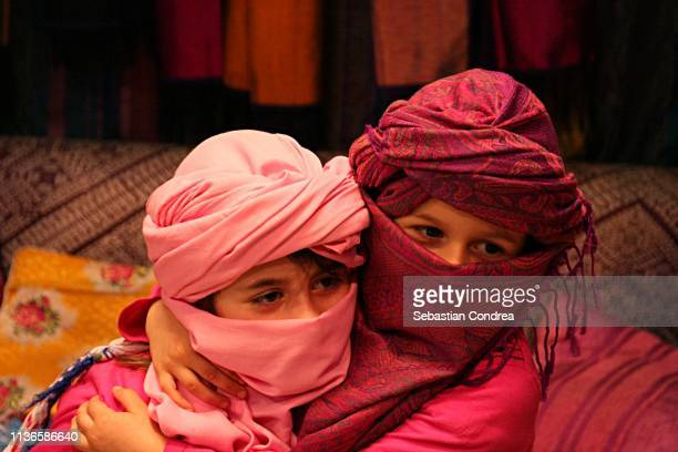 Two girls who embrace, Marrakesh, Morocco.