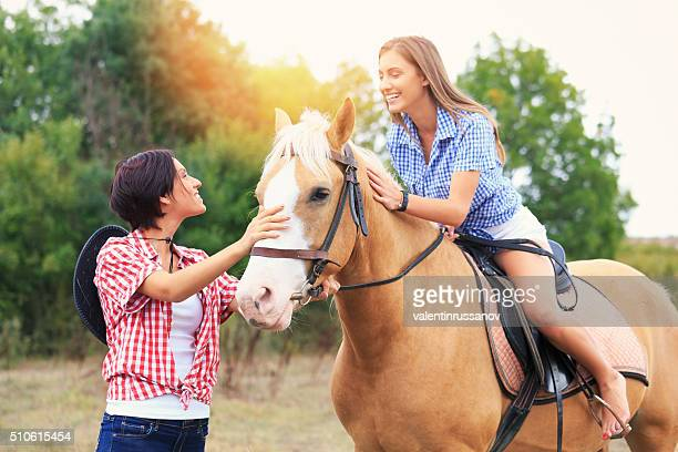 Two girls with horse in nature