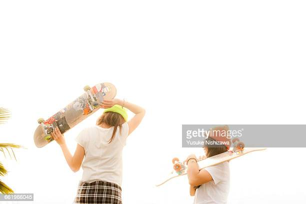two girls with the skateboard - yusuke nishizawa stock pictures, royalty-free photos & images
