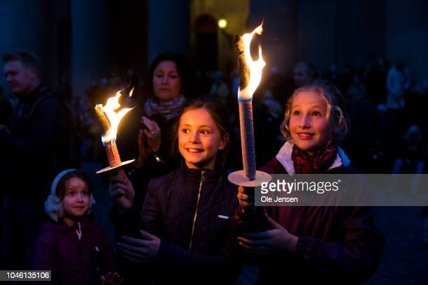 Two girls with torches during the memorial procession for the deceased musician Kim Larsen on October 5, 2018 in Copenhagen, Denmark. Kim Larsen died...