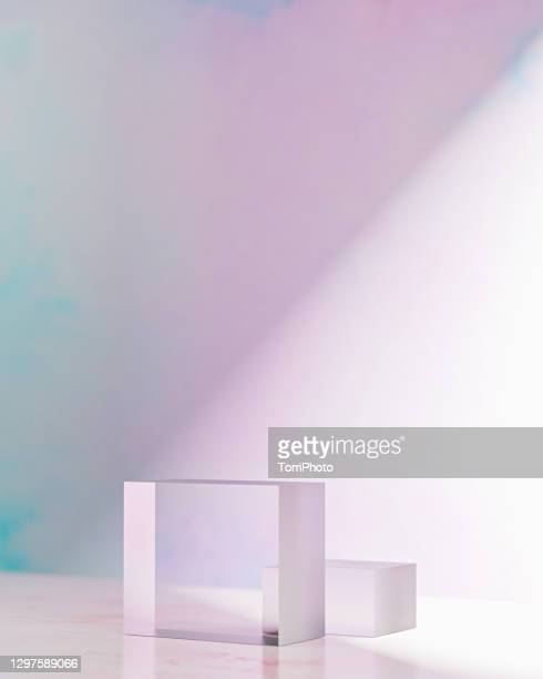 two glass cube prisms on pink background - glass material stock pictures, royalty-free photos & images