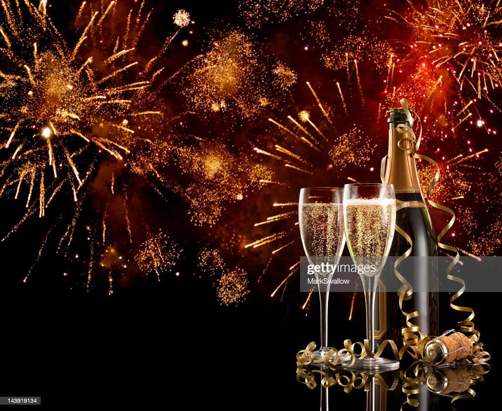 Two glasses and a bottle of champagne on New Years Eve : Stock Photo