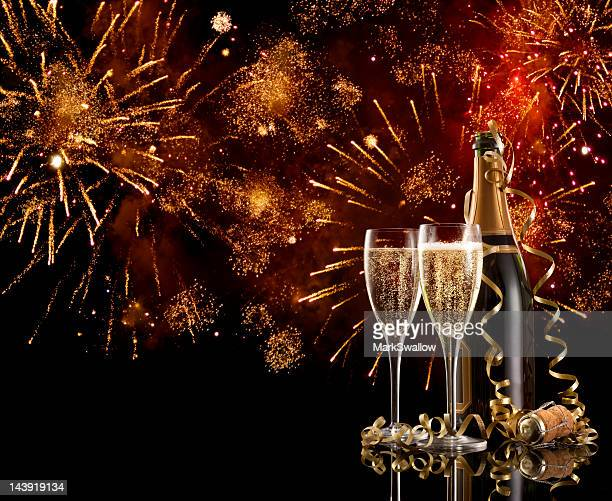 two glasses and a bottle of champagne on new years eve - exploding glass stock photos and pictures