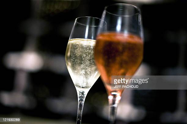 Two glasses of AOC 'Crémant de Bourgogne' wine are displayed at the Bailly Lapierre cellars on August 19 2011 in the French central city of...