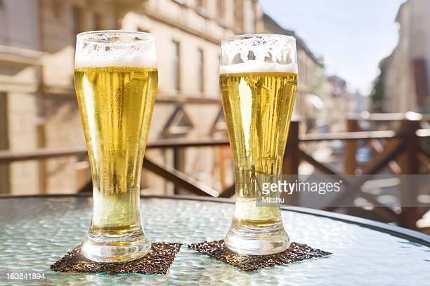 Two glasses of beer in sidewalk cafe
