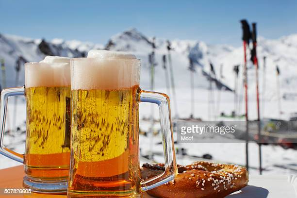 Two glasses of beer on outdoor cafe table, Austria