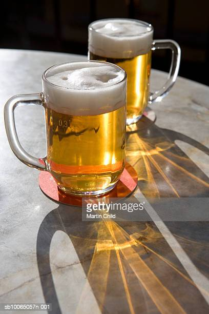 Two glasses of beer on table