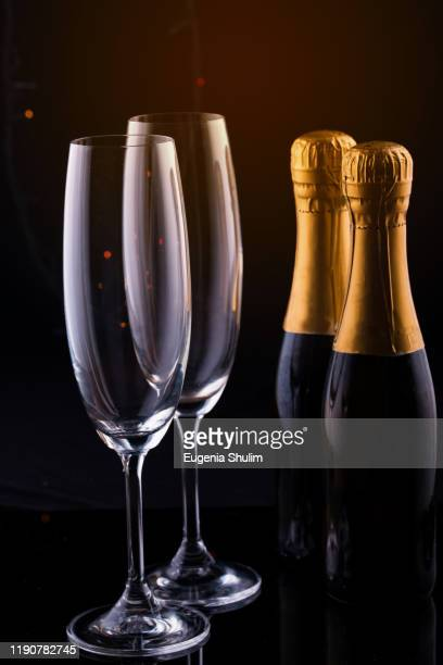 two glasses champagne against blurred christmas