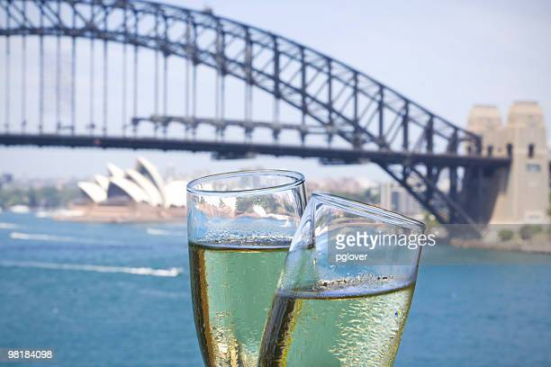 Two glasses of champagne in front of Sydney Harbour bridge