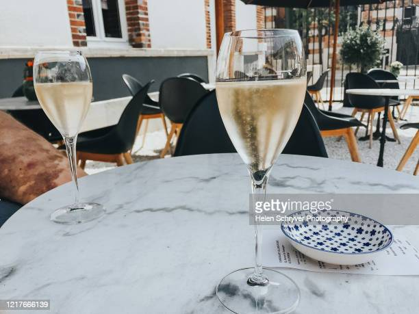 two glasses of champagne on marble table - campania stock pictures, royalty-free photos & images