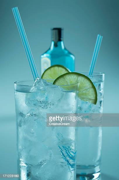 Two glasses of chilled drinks with lime