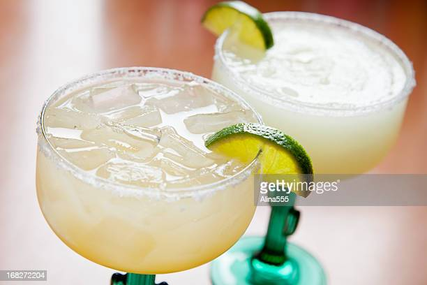 Two glasses of classic margarita: on the rocks and blended