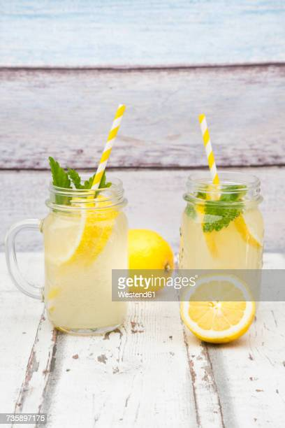 Two glasses of cooled lemonade flavoured with lemon balm