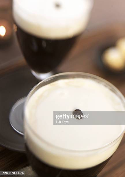 Two glasses of Irish coffee, elevated view, close-up.