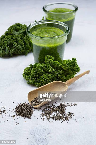 Two glasses of kale smoothie and chia seeds