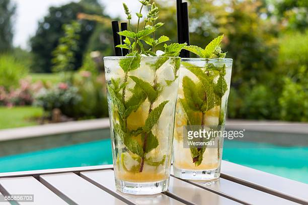 two glasses of mojito - mojito stock photos and pictures