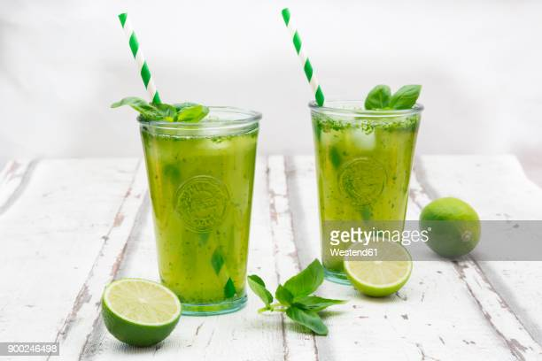 two glasses of organic lime lemonade with basil - cold drink stock pictures, royalty-free photos & images